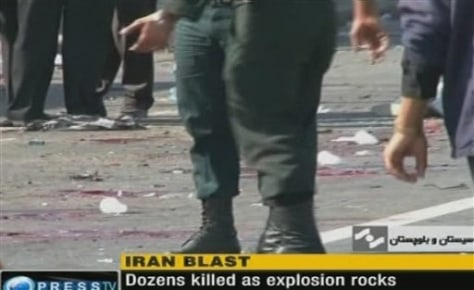 Image: Members of Iranian security forces near site of bomb blast
