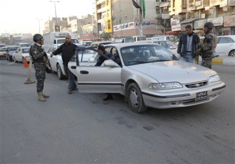 Image: Security forces search people and cars