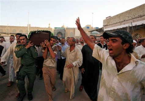 Image: Mourners carry a coffin