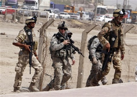Image: U.S. Army soldiers and Iraqi security forces secure the scene of a roadside bomb attack in Basra, Iraq