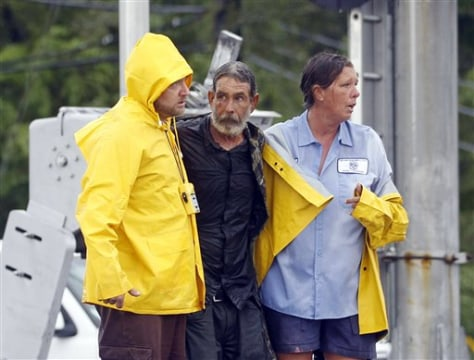 Image: Larry Bailey, center, is helped to safety in Slidell, La.