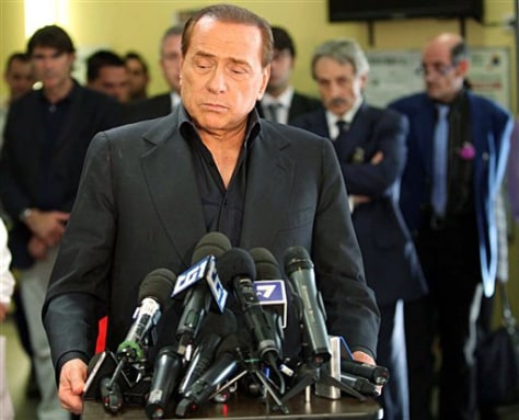 image: Italian Premier Silvio Berlusconi meets journalists in Milan.
