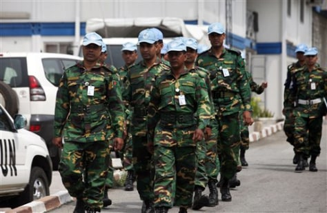 Image: UN troops walk inside the UN Headquarters in Abiidjan, Ivory Coast