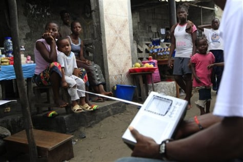Image: Liberians listen to election results