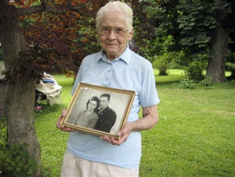 Image: Jean Stevens with photo of husband