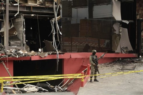 Image: A soldier stands guard outside the Casino Royale after a deadly assault that killed at least 52 people in Monterrey, Mexico.