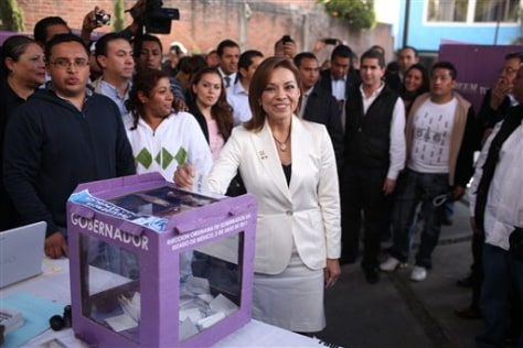 Josefina Vasquez Mota, new presidential candidate of Mexico's National Action Party, casts her vote during the party's primary elections in Huixquilucan, Mexico, Sunday.
