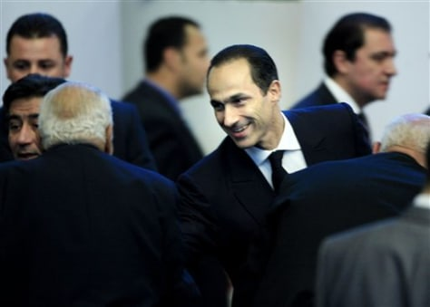 Image: Gamal Mubarak, the son of Egyptian President Hosni Mubarak, greets attendee
