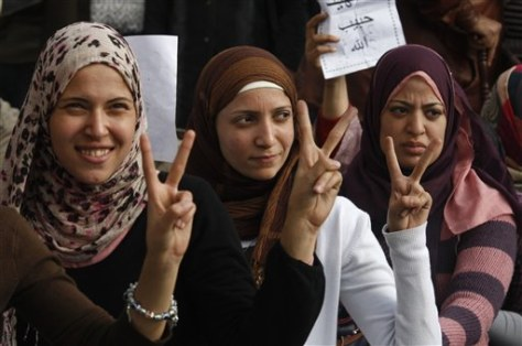 Image: Three women gesture for victory