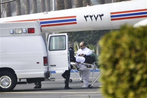 Image: Former President Hosni Mubarak is wheeled into a van after attendinga trial in Cairo Wednesday