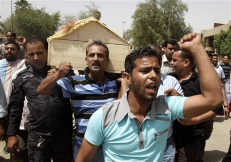 Image: Mourners carry the coffin of Brigadier Muaeid Mohammed Saleh during his funeral in Baghdad