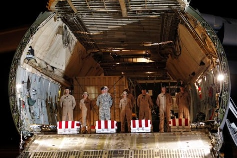Image: Transfer cases containing the U.S. soldiers' remains sit inside a U.S. Air Force C-5 cargo plane upon arrival at Dover Air Force Base, Del.