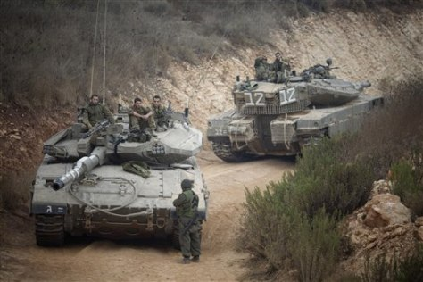 Image: Israeli soldiers on tanks