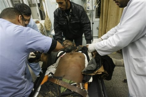 Image: Medics treat a wounded Palestinian militant at Al Najar hospital
