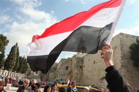 Image: A Palestinian holds up an Egyptian flag