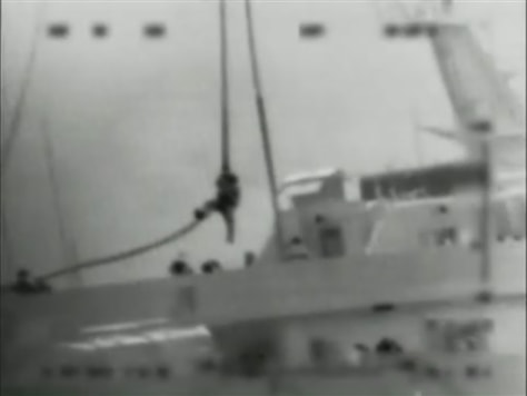 Image: One of several commandos is dropped onto the Mavi Marmara ship by helicopter in the Mediterranean Sea