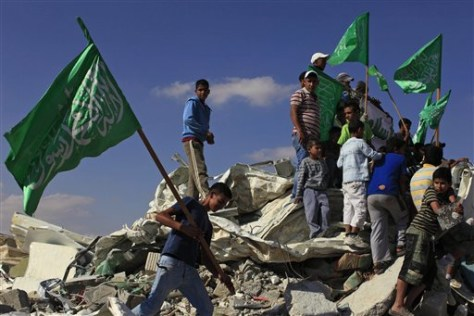 Image: Israeli Arab youths hold green Islamic flags