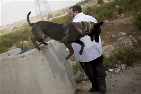 Image: Israeli Mike Guzafsky, 47, with a dog