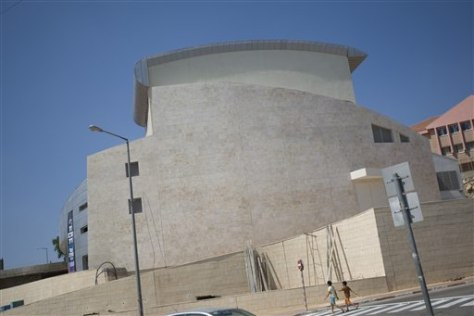 Image: Israeli children walk past Ariel's new theater in the West Bank
