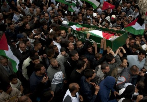 Image: Palestinians carry the body of Milad Said Ayyash, 17