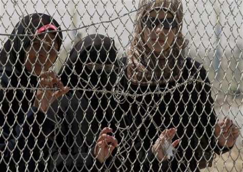Image: Palestinian women wait to cross to Egypt on Tuesday at the Rafah border crossing, southern Gaza Strip.