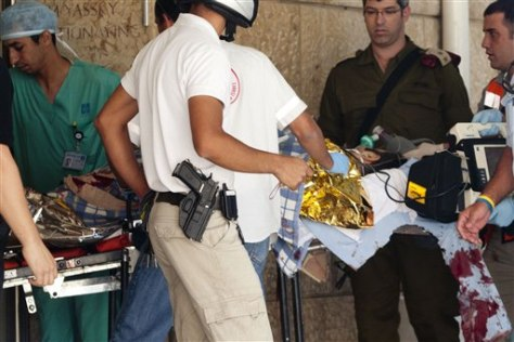 Image: Israeli medics carry an injured police officer