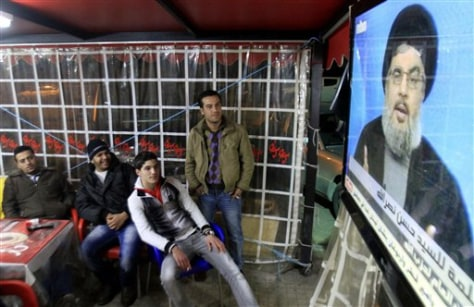 Image: People watch the speech of Hezbollah leader Hassan Nasrallah on a screen
