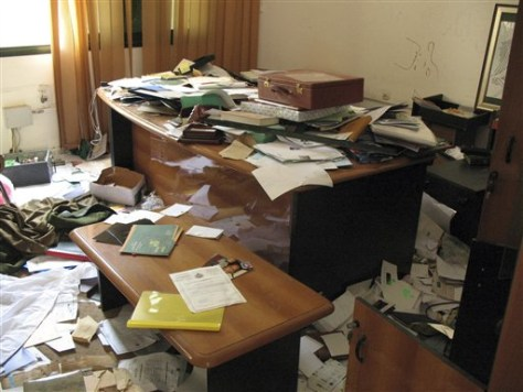 Image: A ransacked desk in Moammar Gadhafi's intelligence headquarters