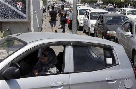 Image: Libyan woman at a women-only gas station