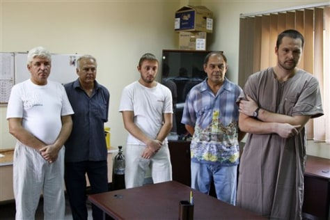 Image: Ukrainians living in Libya and suspected of being mercenaries for Moammar Gadhafi are detained