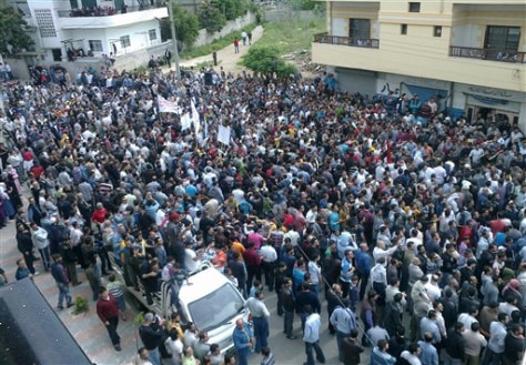 Image: Syrians gather after Friday prayers