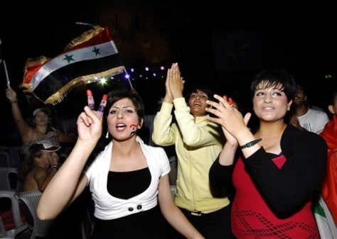 Image: Supporters of Syrian President Bashar Assad shout slogans and wave their national flag