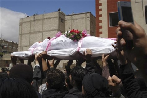 Image: Syrian anti-government protesters carry a coffin