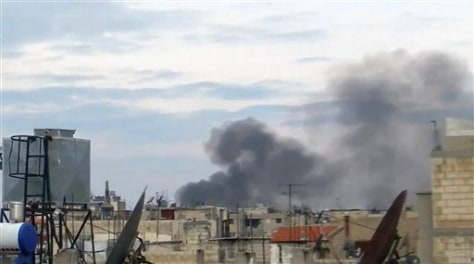 Image: Smoke billows from explosions from Homs