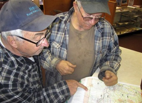 Image: Mel Basanez, left, and Bill Landon, look at a map