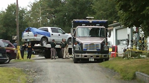 Image: A silver pickup truck is removed from the home of Celina Cass