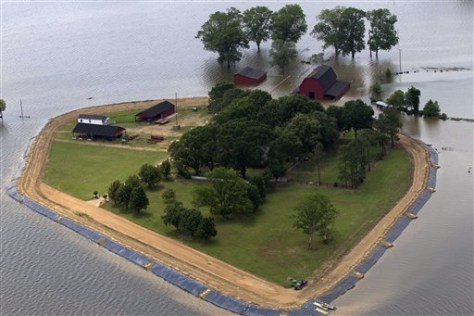 Image: A home is protected by a levee