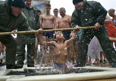 IMAGE: BOY IN ICE COLD WATER