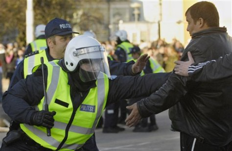 IMAGE: POLICE CONFRONT PROTESTER