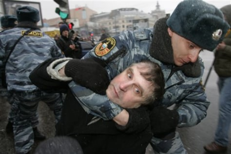 IMAGE: OFFICER ARRESTS ACTIVIST