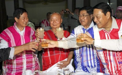 Image: Government and Karen negotiators raise their glasses during a dinner Wednesday.