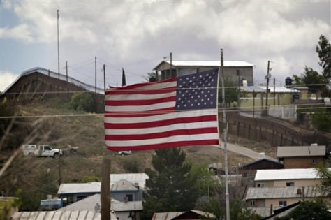 Image: American flag flies along international border in Nogales, Ariz.