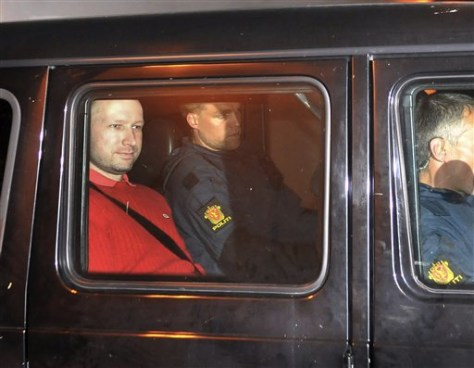 Image: Suspect Anders Behring Breivik, left, sits in an armored police vehicle earlier this week.