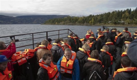 Image: Journalists abaord ferry o Utoya island in Norway