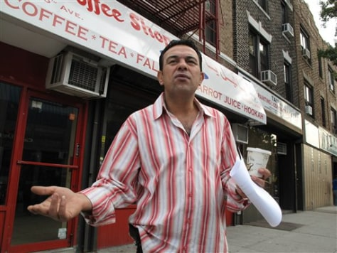 Image: Mousa Ahmad stands in front of the empty storefront where he used to run a coffee shop in Brooklyn