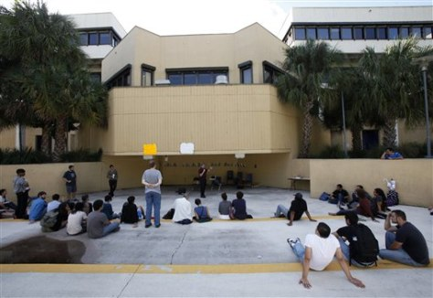 Image: Students listen to political science professor Ron Cox during an Occupy FIU Teach-In