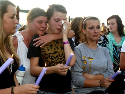 Image: People mourn during a prayer vigil in Copley Township, Ohio