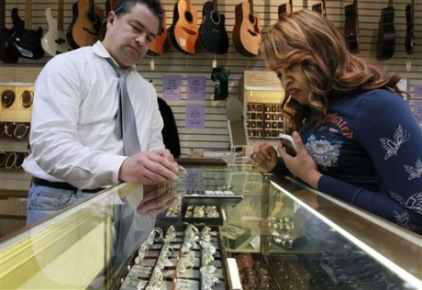Image: Roy Knudsen, of Boston, left, displays earrings to Doreena Ruiz, of Framingham, Mass., at Suffolk Jewelers & Pawnbrokers, in Boston.