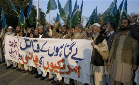 Image: People chant slogans in Pakistan