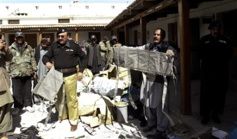 Image: Pakistani police officers show off explosive jackets